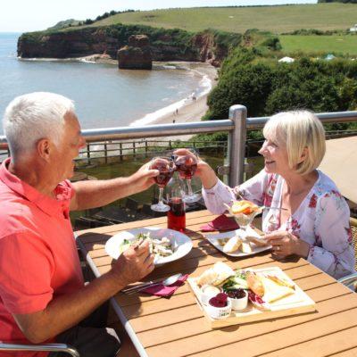 Couple eating overlooking Ladram Bay