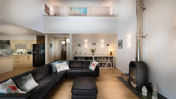 Open plan living room with wood burner